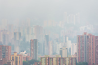 High rise luxury apartment buildings of El Poblado neighborhood are seen submerged in a morning fog, rolling on the hills of Medellín, Colombia, 28 February 2016.