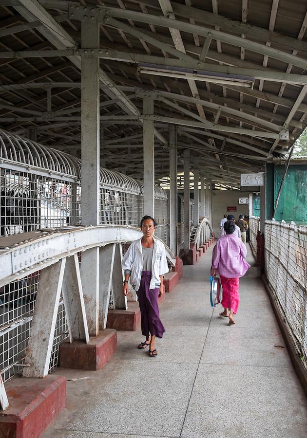 YANGON, MYANMAR - CIRCA DECEMBER 2013: Passenger walks at the at the Yangon Central Railway Station