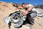 Fred Pavey, a British explosive ordnance disposal technician, inspects part of a Russian-built SA3 missile on June 15 at a former Libyan Air Force site outside Misrata, the besieged Libyan city where civilians and rebel forces are surrounded on three sides by forces loyal to Libyan leader Moammar Gadhafi. The site contained several missiles damaged in a NATO air strike, and a team from the ACT Alliance, concerned about the safety of civilians traveling a nearby road, investigated the site and marked which items need to be safely removed. Pavey works with the humanitarian mine action program of DanChurchAid, which is a member of the ACT Alliance.  Photo by Paul Jeffrey/ACT Alliance.