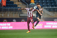 Jose Correa (27) of CD Chivas USA goes up for a header with Jeff Parke (31) of the Philadelphia Union. The Philadelphia Union defeated the CD Chivas USA 3-1 during a Major League Soccer (MLS) match at PPL Park in Chester, PA, on July 12, 2013.