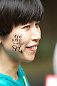 October 15, 2011, Tokyo, Japan - A protester with 'We are the 99%' written on her face at Mikawadai Park. Around 500 protesters took part in 3 separate protests in support of the Occupy Tokyo movement. The protesters airing a series of issues including Anti-Nuclear, Anti-Capitalism and Anti-TPP. They chanted '1% no thank you' and ' Nuclear no thank you ' at the rallies. Protesters in the Roppongi's Mikawadai Park numbered about 60 and were out numbered by around 70 Police and 40 members of the media. (Photo by Bruce Meyer-Kenny/AFLO) [3692]