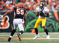 Markus Wheaton #11 of the Pittsburgh Steelers catches a pass in front of Vontaze Burfict #55 of the Cincinnati Bengals during the game at Paul Brown Stadium on December 12, 2015 in Cincinnati, Ohio. (Photo by Jared Wickerham/DKPittsburghSports)