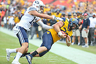 Landover, MD - September 24, 2016: BYU Cougars defensive back Kai Nacua (12) tackles West Virginia Mountaineers tight end Elijah Wellman (28) during game between BYU and WVA at  FedEx Field in Landover, MD.  (Photo by Elliott Brown/Media Images International)