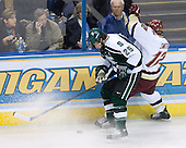 Jim McKenzie (Michigan State - Woodbury, MN) blocks Ben Smith (Boston College - Avon, CT). The Michigan State Spartans defeated the Boston College Eagles 3-1 (EN) to win the national championship in the final game of the 2007 Frozen Four at the Scottrade Center in St. Louis, Missouri on Saturday, April 7, 2007.