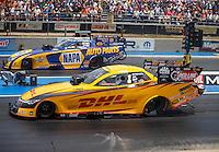 Jul 24, 2016; Morrison, CO, USA; NHRA funny car driver Del Worsham (near) races alongside Ron Capps during the Mile High Nationals at Bandimere Speedway. Mandatory Credit: Mark J. Rebilas-USA TODAY Sports