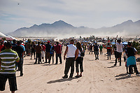 Spectators await arrival of 1st trophy truck at finish of 2011 San Felipe Baja 250