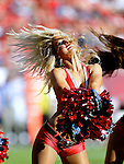 A Tampa Bay Buccaneer cheerleader entertains the crowd during a game between the  Buccaneers and the Atlanta Falcons Sunday, November 25, 2012, in Tampa, Fla. The Falcons defeated the Buccaneers 24-23.  (AP Photo/Margaret Bowles)