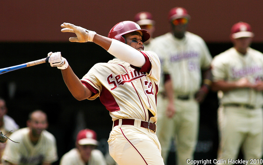 TALLAHASSEE, FL 6/13/10-FSU-VANDY BASE10 CH-Florida State's Sherman Johnson hits in the seventh inning against Vanderbilt during Super Regional action Sunday at Dick Howser Stadium in Tallahassee...COLIN HACKLEY PHOTO