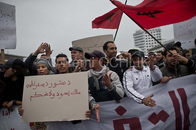 "© Remi OCHLIK/IP3 -  February 20 2011  Casablanca - Morocco -  Thousands of protesters took to the streets in Morocco on Sunday demanding King Mohammed give up some of his powers, dismiss the government and clamp down on corruption. The banner reads: ""No to get money and power at the same time"""