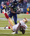 San Francisco 49ers tight end Vernon Davis (85) is separated from the ball after being hit by Seattle Seahawks strong safety, Kam Chancellor, (31) , during the NFL  Championship Game at CenturyLink Field in Seattle, Washington on January 19, 2014.  The Seahawks beat the  49ers 23-17 to represent the NFC in the Super Bowl. ©2014. Jim Bryant Photo. ALL RIGHTS RESERVED.