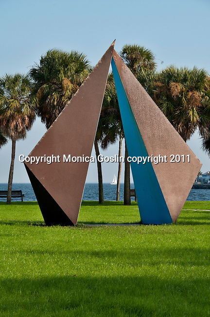 The Vinoy Park in St. Petersburgh, Florida with a sculpture by Rolf Brommelsick (made in 1980) titled Truth and a sailboat in Tampa Bay in the background