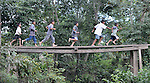 Children run across a small bridge in Santa Elena, in Guatemala's Peten region.