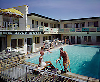 Woman on the diving board & man coming out of the pool at the El Ray Motel, Wildwood NJ