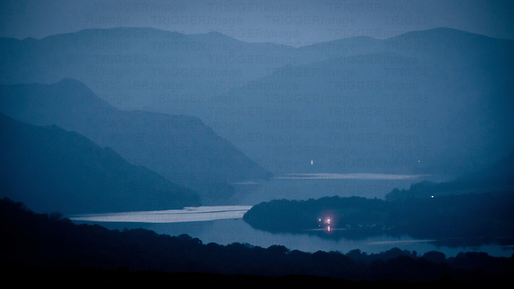 House lights showing across Ullswater lake at twilight