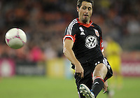 WASHINGTON, DC - OCTOBER 20, 2012:  Branko Boskovic (8) of D.C United sends over the pass to Lewis Neal (24) that resulted in the winning goal against the Columbus Crew during an MLS match at RFK Stadium in Washington D.C. on October 20. D.C United won 3-2.