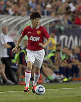 Manchester United FC midfielder Ji-Sung Park (13) dribbles down the wing. In a Herbalife World Football Challenge 2011 friendly match, Manchester United FC defeated the New England Revolution, 4-1, at Gillette Stadium on July 13, 2011.