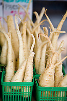 Parsnip roots for sale at a farmers market.