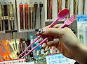 February 9, 2012, Tokyo, Japan - A cutlery which can be used as a pair of chopsticks, a spoon or a fork is shown in the Tokyo International Gift show at the Big Sight in Tokyo on Thursday, February 9, 2012. A total of 2,500 companies, including 220 from 22 foreign countries and regions, showcased three million amazing new products during the three-day exhibition. (Photo by Natsuki Sakai/AFLO) AYF -mis-