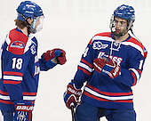 A.J. White (UML - 18), Joseph Pendenza (UML - 14) - The Boston College Eagles defeated the visiting University of Massachusetts Lowell River Hawks 3-0 on Friday, February 21, 2014, at Kelley Rink in Conte Forum in Chestnut Hill, Massachusetts.