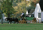 Horse and Carriage Colonial Williamsburg Virginia, carriage, horse, wheels, colonial,  Colonial carriage, Colonial Williamsburg Virginia, horse drawn carriage, coach, horses clopping, coble stone streets, stage wagon, stable, historic area, Carriage wheel trundle beneath Duke of Gloucester Street, groomed horses, horses with polished harness brass leather for wear, horses to the carriages, blacksmith, harness, coachman, Fine Art Photography by Ron Bennett, Fine Art, Fine Art photography, Art Photography, Copyright RonBennettPhotography.com ©
