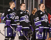 Nick Finn (HC - 26), Ryan McGrath (HC - 23), Tim Driscoll (HC - 22) - The Bentley University Falcons defeated the College of the Holy Cross Crusaders 3-2 on Saturday, December 28, 2013, at Fenway Park in Boston, Massachusetts.