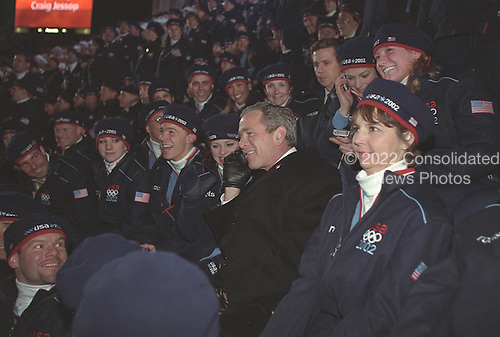 United States President George W. Bush speaks on a cell phone as he observes the Winter Olympics Opening Ceremony at Rice-Enclose Stadium in Salt Lake City, Utah, Friday, February 8, 2002. .Mandatory Credit: Paul Morse - White House via CNP.