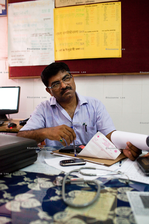 Dr. Hari Dutt Nemi, Chief Medical Superintendent (CMS) of Muradnagar in his office in the Muradnagar Community Health Centre (CHC) in Ghaziabad, Uttar Pradesh, India. Photo by Suzanne Lee / Panos London