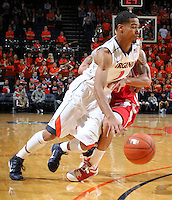 Dec. 07, 2010; Charlottesville, VA, USA; Virginia Cavaliers guard Mustapha Farrakhan (2) drives past Radford Highlanders guard Jareal Smith (4) during the game at the John Paul Jones Arena. Virginia won 54-44. Mandatory Credit: Andrew Shurtleff