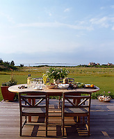 The extensive wooden decking which surrounds the property provides a great space for 'al fresco' dining