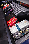 Row of suitcases on airport baggage claim conveyor carousel, Toronto Pearson International Airport, Ontario, Canada