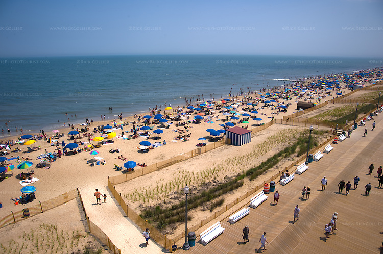 Rooftop view of beachgoers and sunbathers on the beach and boardwalk at Rehoboth Beach, Delaware, USA.