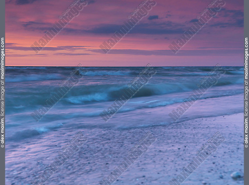 Beautiful tranquil sunset scenery of lake Huron in soft red and blue colors, Pinery Provincial Park, Grand Bend, Ontario, Canada.