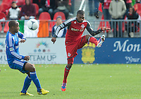 20 October 2012: Toronto FC defender Ashtone Morgan #5 and Montreal Impact midfielder Collen Warner #18 in action during an MLS game between the Montreal Impact and Toronto FC at BMO Field in Toronto, Ontario..The game ended in a 0-0 draw..