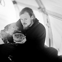Stian Araakjaer Jorgensen, 30, eats his dinner in a tent. He has already spent 22 months with the Sirius Patrol based at Daneborg. Established on the east coast of Greenland in 1950, Daneborg is the base for the Sirius Patrol, a Danish navy unit which patrols and enforces Danish sovereignty in the Arctic regions of Northern and Eastern Greenland. The Sirius Patrol is a Danish navy unit which patrols and enforces Danish sovereignty in the Arctic regions of Northern and Eastern Greenland.