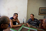 Chinese-Cubans play mah-jong at a community center in Chinatown, Havana, Cuba, on Friday, April 18, 2008. At its height, the ethnic Chinese population in Cuba was about 40,000. There were three Chinese movie theaters, independent businesses, a bank, a theater that contracted Chinese performers and three Chinese newspapers, one of which still publishes today.