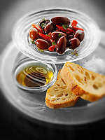 Olives and bread with dipping oil