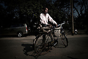 40 year old recycler, Suresh Kumar poses for a portrait in New Delhi, India. Photo: Sanjit Das