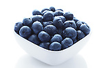 Organic blueberries in high resolution in a white bowl