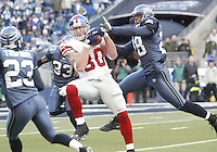 New York Giants tight end Jeremy Shockey hauls in a Eli Manning pass in front of Seattle Seahakws #23 Marcus Trufant, #28 Michael Boulware and #33 Marquand Manuel during the second quarter at Quest Field in Seattle, WA.