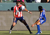 Chivas USA forward Alan Gordon attempts to move around Wizards midfielder Roger Espinoza. The Kansas City Wizards defeated CD Chivas USA 2-0 at Home Depot Center stadium in Carson, California on Sunday September 19, 2010.