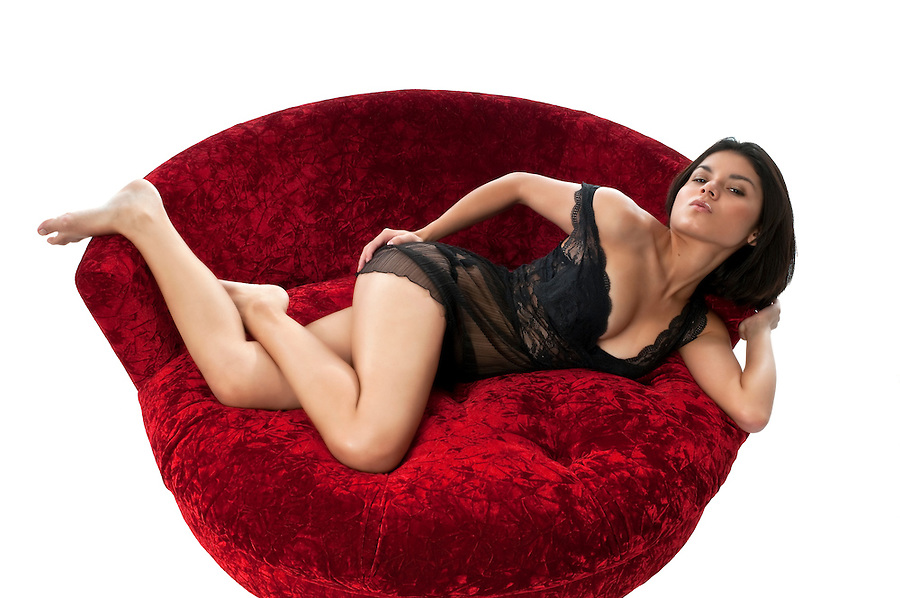 Hot latin girl in lingerie resting in sofa very sexy.