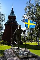 Sweden, Mora. Mora-Nisse statue.