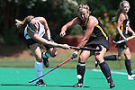 30 August 2014: Wake Forest's Georgia Holland (left) and Iowa's Dani Hemeon (right). The Wake Forest University Demon Deacons played the University of Iowa Hawkeyes at Francis E. Henry Stadium in Chapel Hill, North Carolina as part of the ACC/Big 10 Challenge and an 2014 NCAA Division I Field Hockey match. Iowa won the game 4-1.