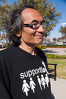 Dean, a marcher at the Occupy Orange County, Irvine march on November 5, smiles.
