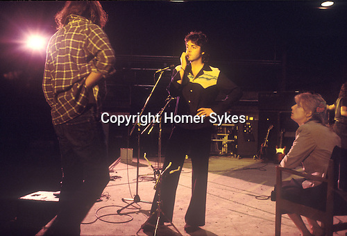 "Paul and Linda McCartney Wing Tour 1973.Rehearsal stage north London  1970s UK The photographs from this set were taken in 1975. I was on tour with them for a children's ""Fact Book"". This book was called, The Facts about a Pop Group Featuring Wings. Introduced by Paul McCartney, published by G.Whizzard. They had recently recorded albums, Wildlife, Red Rose Speedway, Band on the Run and Venus and Mars. I believe it was the English leg of Wings Over the World tour. But as I recall they were promoting,  Band on the Run and Venus and Mars in particular."