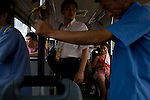 A Chinese Olympic team fan shows her support while riding the city bus in Beijing, China on Monday, August 4, 2008. The city of Beijing is gearing up for the opening ceremonies of the Olympic Games.  Kevin German