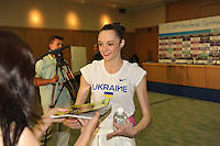 September 11, 2009; Mie, Japan;  Anna Bessonova of Ukraine receives gift from fan at press interview after winning bronze in the All Around final on this day at 2009 World Championships Mie. Anna was the 2007 AA world champion at Patras, Greece in the individual All Around. Photo by Tom Theobald. .