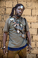 An Anti-Balaka (Anti-Machete) fighter draped with 'Gris Gris' amulets that confer good fortune and protection on the wearers. They are animist in origin but also worn by both Muslims and Christians throughout west and central Africa. In late 2012 after years of instability and conflict, the Seleka, a predominantly Muslim rebel group, fuelled by grievances against the government, overran the country and, In March 2013, ousted President Francois Bozize, who fled the country. The rebel's leader Michel Djotodia was proclaimed president in August 2013. He disbanded the Seleka in September 2013 but law and order collapsed and ex-Seleka fighters roamed the country committing atrocities against the civilian population. In an attempt to defend their lives and property vigilante groups, calling themselves Anti-Balaka (Anti-Machete), formed to confront the ex-Seleka fighters but soon began to take reprisals against the wider Muslim population and the conflict became increasingly sectarian. By December 2013, with international fears of a genocide being voiced, French led peacekeepers deployed to the country began to act on a UN mandate to disarm the fighters and protect the civilian population. However, they have struggled to contain the situation. Much of the Muslim population, in particular, have been forced into ghettos where they are suffering from food shortages and limited access to healthcare. Often, only a few peacekeepers stand between them and a massacre by vengeful Anti-Balaka militants. UN reports describe 'thousands' killed, while over 600,000 people have been internally displaced and a further 200,000 have fled the county.