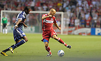 Chicago midfielder Freddie Ljungberg (8) makes a move against New York midfielder Macoumba Kandji (10).  The Chicago Fire tied the New York Red Bulls 0-0 at Toyota Park in Bridgeview, IL on August 8, 2010