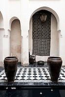 The black and white tiled floor of the riad's central courtyard is in striking contrast to the simplicity of the bare plaster walls